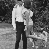 Michael Caine sweeps Natalie Wood off her feet, 1963