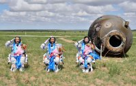 Astronauts Zhang, Nie and Wang salute after returning to earth in re-entry capsule of China's Shenzhou-10 spacecraft at its main landing site in north China's Inner Mongolia Autonomous Region