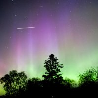 A 15 second time exposure shows the International Space Station passing above the Aurora Borealis (Northern Lights) as viewed From Blackduck Minn., on June 6, 2013. (Justin Dernier / Corbis)
