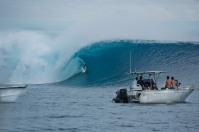 Danny Fuller goes deep on a large wave, Cloudbreak, Fiji.