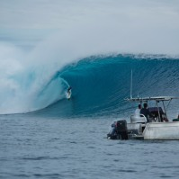 Danny Fuller goes deep on a large wave, Cloudbreak, Fiji.