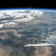 Thick smoke billows across the landscape in these digital photographs of the western United States. Both photographs were taken by astronauts aboard the International Space Station (ISS) on June 19, 2013.
