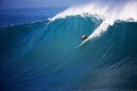 Kelly Slater surfs a Perfect 10 at the 2010 Eddie Aikau Big Wave event in Waimea Bay, Hawaii.