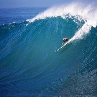 Kelly Slater surfs a Perfect 10 at the 2010 Eddie Aikau Big Wave event in Waimea Bay, Hawaii.