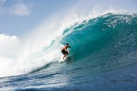 A surfer rides through the barrel of a wave, Pipeline, Hawaii.
