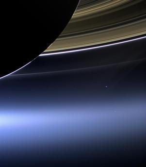 The Day the Earth Smiled: In this rare image taken on July 19, 2013, the wide-angle camera on NASA's Cassini spacecraft has captured Saturn's rings and our planet Earth and its moon in the same frame. It is only one footprint in a mosaic of 33 footprints covering the entire Saturn ring system (including Saturn itself). At each footprint, images were taken in different spectral filters for a total of 323 images: some were taken for scientific purposes and some to produce a natural color mosaic. This is the only wide-angle footprint that has the Earth-moon system in it.