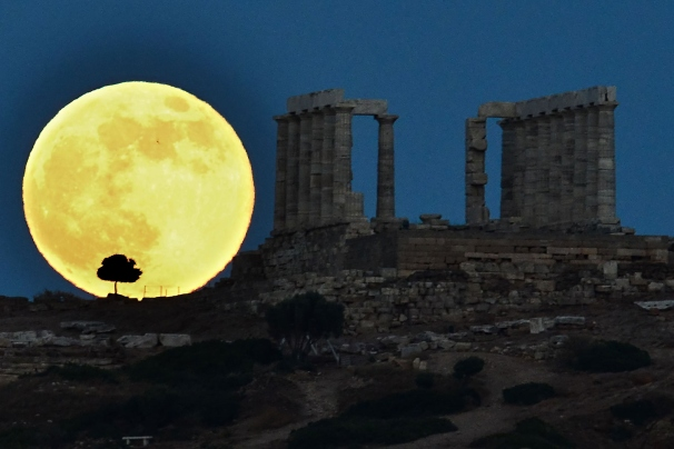 A supermoon rises next to the ancient Greek temple of Poseidon at Cape Sounion, some 65 kilometers south of Athens, on June 23, 2013.
