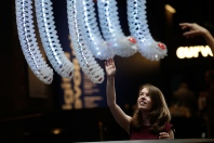 The Petting Zoo entices visitors to interact with playful robotic arms.